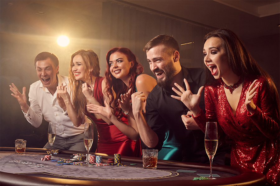 Poeple smilling and Casino Games table, evening events at Eventurous