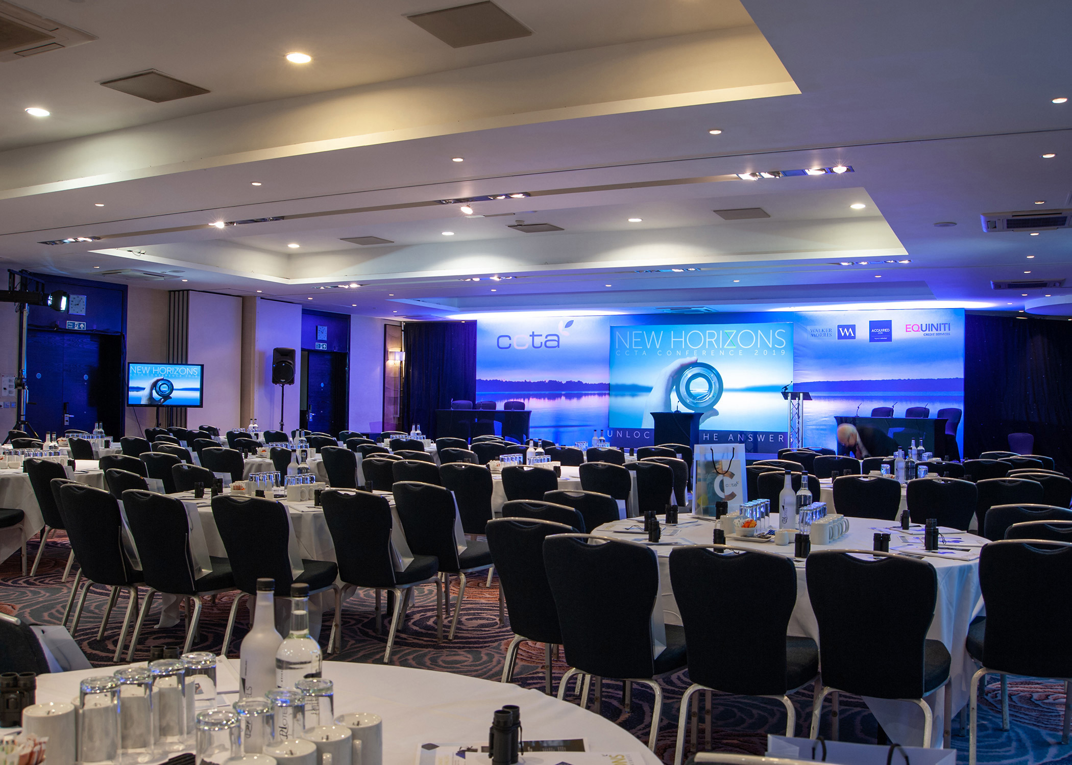 Conferences, indoor tables and chairs and LED wall.